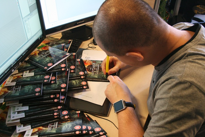 CD_Projekt_Red_Team_Signing_Xbox_Game_Boxes.jpg